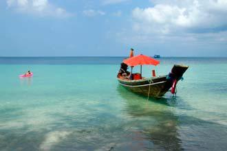 Barco-táxi para ligações entre as praias de Koh Tao